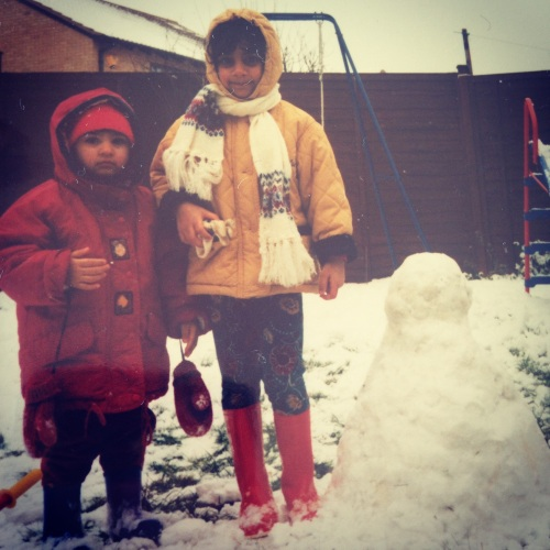 Me and Laura building snowmen in the back garden